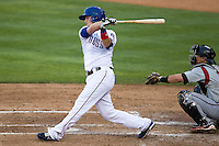 Round Rock third baseman Alex Buchholz (5) follows through on his swing in the Pacific Coast League baseball game against the Nashville Sounds on May 4, 2013 at the Dell Diamond in Round Rock, Texas. Round Rock defeated Nashville -6. (Andrew Woolley/Four Seam Images).