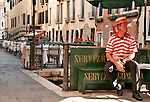 A gondolier takes a break in Venice, Italy