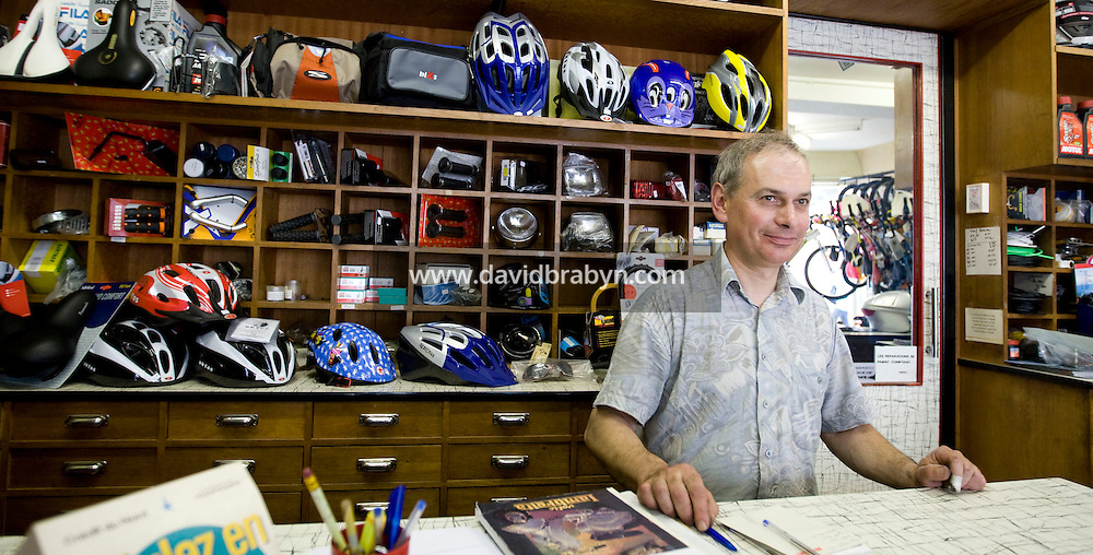 Dominique Leduc poses in bicycle store in Amboise in France, 25 June 2008.