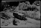 RGS Goose #5 southbound in snow, passing the Newmire road bridge at Vanadium.<br /> RGS  Vanadium (Newmire), CO  Taken by Maxwell, John W. - 5/26/1949