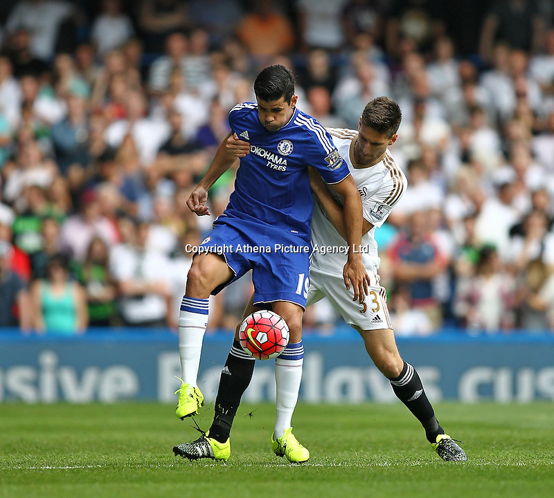Diego Costa of Chelsea battles with Federico Fernandez of Swansea   during the Barclays Premier League match between  Chelsea and Swansea  played at Stamford Bridge, London