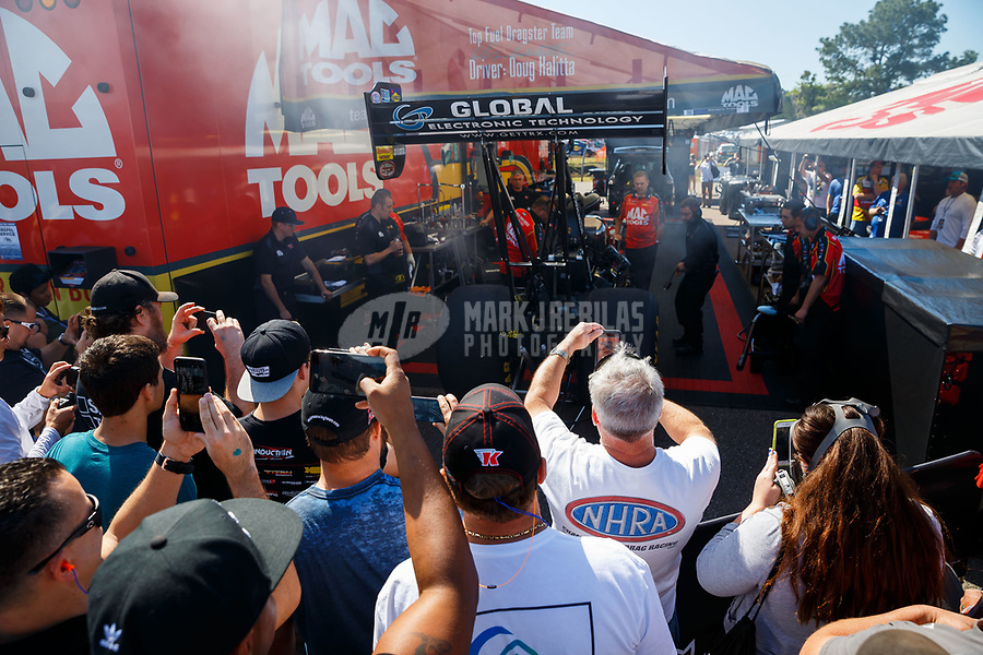 Mar 18, 2017; Gainesville , FL, USA; Fans surround the pit area of NHRA top fuel driver Doug Kalitta as he warms up his engine during qualifying for the Gatornationals at Gainesville Raceway. Mandatory Credit: Mark J. Rebilas-USA TODAY Sports
