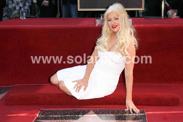 **ALL ROUND PICTURES FROM SOLARPIX.COM**                                             **SYNDICATION RIGHTS FOR UK, AUSTRALIA, DENMARK, PORTUGAL, S. AFRICA, SPAIN & DUBAI (U.A.E) & ASIA (EXCLUDING JAPAN) ONLY**                                                                                  Caption: Christina Aguilera Honored with a Star on the Hollywood Walk of Fame, Hollywood Boulevard, CA, USA, 15 November 2010                                                                              This pic: Christina Aguilera                                                                                              JOB REF:12483    PHZ charlotte    DATE: 15_11_2010                                                            **MUST CREDIT SOLARPIX.COM OR DOUBLE FEE WILL BE CHARGED**                                                                      **MUST AGREE FEE BEFORE ONLINE USAGE**                               **CALL US ON: +34 952 811 768 or LOW RATE FROM UK 0844 617 7637**