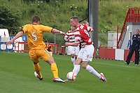 Jon McShane slips the ball past Shaun Hutchinson in the Hamilton Academical v Motherwell friendly match played at New Douglas Park, Hamilton on 24.7.12..