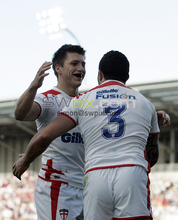 PICTURE BY VAUGHN RIDLEY/SWPIX.COM - Rugby League - International - England v France - Leigh Sports Village, Leigh, England - 12/06/10...Copyright - Simon Wilkinson - 07811267706...England's Tom Briscoe (L) congratulates Chris Bridge on his try.