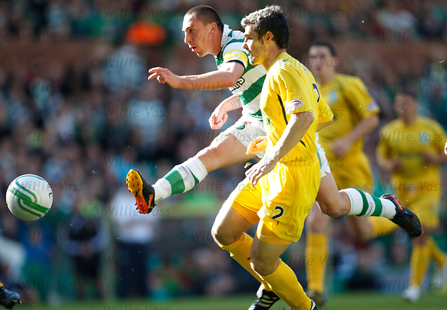 Scott Brown volleys in the opening goal for Celtic as defender Michael Hart looks on