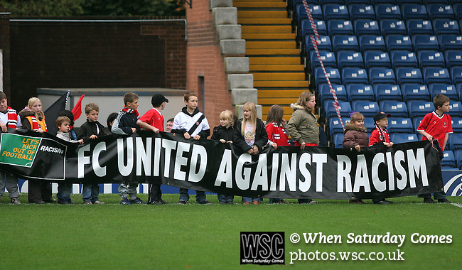 FC United of Manchester 8, Glossop North End 0, 28/10/2006. Gigg Lane, Bury, North West Counties League division one. Young fans holding up anti-racism banners before FC United of Manchester take on Glossop North End (blue shirts) in a North West Counties division one match at United's home stadium, Gigg Lane, home to Bury FC. The match was staged on People United Day, an event started in 1999 which brought together fans from across Europe to campaign against racism. FC United were formed in the summer of 2005 by supporters of Manchester United in response to the take over of their club by American millionaire Malcolm Glazer and his family. The club entered the football pyramid at the lowest level with the intention to climbing through the leagues. FCUM won the match 8-0, watched by 3257 spectators. Photo by Colin McPherson.