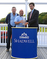 Connections of Mooroverthebridge receive their trophy  after winning The Shadwell Stud Racing Excellence Apprentice Handicap  during Afternoon Racing at Salisbury Racecourse on 17th May 2018