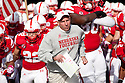 29 October 2011: Head coach Bo Pelini of the Nebraska Cornhuskers leads out his Cornhuskers before the game against the Michigan State Spartans at Memorial Stadium in Lincoln, Nebraska.  Nebraska defeated Michigan State 24 to 3.
