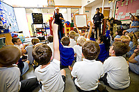 Firefighters on a visit to a local primary school. Children are being taught on what to do in case of fire at home. They are given a talk and shown a video. Oxfordshire UK. This image may only be used to portray the subject in a positive manner..©shoutpictures.com..john@shoutpictures.com