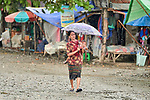 A woman and her child walk along a street in Tuingo, an ethnic Chin village in Myanmar.