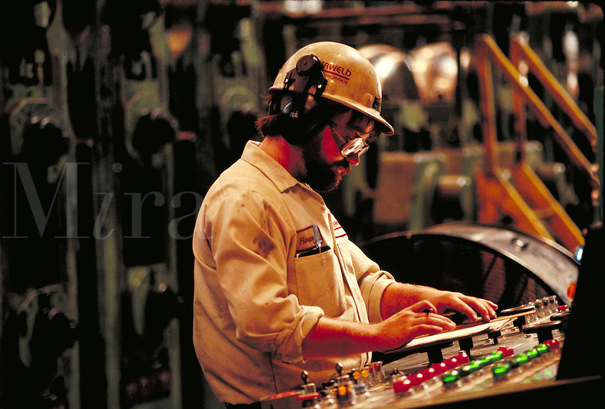 Man operating computerized controls at steel fabrication plant. Birmingham Alabama, Copperweld.