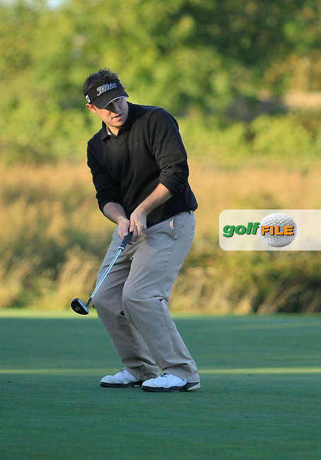 Shane Deegan (Spawell Driving Range) on the 8th green during Round 1 of The Cassidy Golf 103rd Irish PGA Championship in Roganstown Golf Club on Thursday 10th October 2013.<br /> Picture:  Thos Caffrey / www.golffile.ie
