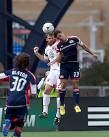 DC United defender Daniel Woolard (21) and New England Revolution midfielder Ryan Guy (13) battle for head ball. In a Major League Soccer (MLS) match, DC United defeated the New England Revolution, 2-1, at Gillette Stadium on April 14, 2012.