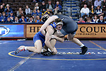 SIOUX FALLS, SD - NOVEMBER 15: Laken Cook from South Dakota State grabs the leg of Chris Barker from Binghamton during their 157 pound match Friday night at the Sanford Pentagon in Sioux Falls, SD. (Photo by Dave Eggen/Inertia)