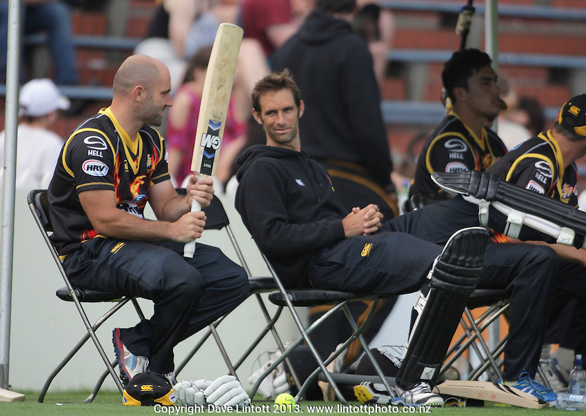 Luke Woodcock and Grant Elliott chat during the HRV Cup Twenty20 cricket match between the Wellington Firebirds and Otago Volts at Hawkins Finance Basin Reserve, Wellington, New Zealand on Friday, 11 January 2013. Photo: Dave Lintott / lintottphoto.co.nz