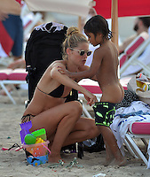 www.acepixs.com<br /> <br /> January 3 2017, Miami Beach, FL<br /> <br /> Former Victoria's Secret model Doutzen Kroes changes her five year old son Phyllon's bathing suit on January 3, 2017 in Miami, Florida<br /> <br /> By Line: Solar/ACE Pictures<br /> <br /> ACE Pictures Inc<br /> Tel: 6467670430<br /> Email: info@acepixs.com<br /> www.acepixs.com