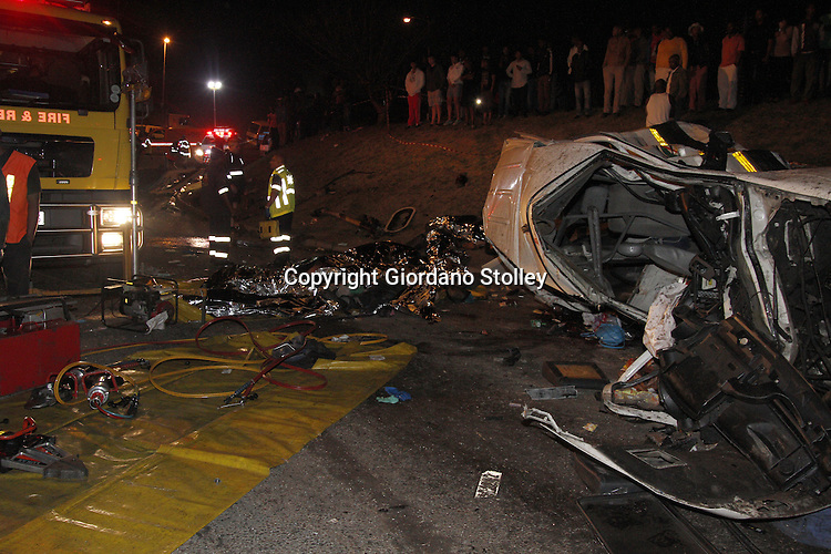DURBAN - 5 September 2013 - Fire crews had to use the jaws of life to extract the wounded and the dead from the wreckage of an accident where 24 people were killed when a lorry's brakes failed on Field's Hill in Pinetown and ploughed through four taxis and a car. Picture: Allied Picture Press/APP