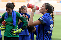Houston, TX - Saturday May 27, 2017: Katie Johnson cools down during a mandatory water break during a regular season National Women's Soccer League (NWSL) match between the Houston Dash and the Seattle Reign FC at BBVA Compass Stadium.