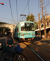 The Enoden streetcar-train line that runs from Fujisawa to Kamakora passing through Enoshima, Japan. Enoshima is a small island next to a small sea-side area in Japan west of Tokyo and Yokohama. <br />