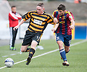 Alloa's Declan McManus gets away from Livy's Kyle Wilkie.
