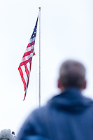 Annapolis, MD - OCT 8, 2016: A Navy fan faces the flag during the anthem before during game between Houston and Navy at Navy-Marine Corps Memorial Stadium Annapolis, MD. The Midshipmen upset #6 Houston 46-40. (Photo by Phil Peters/Media Images International)