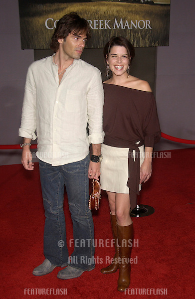 Actress NEVE CAMPBELL & date at the world premiere, in Hollywood, of Cold Creek Manor..Sept 17, 2003