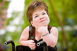 Young woman in wheelchair with MPS VI; patient portrait shot for BioMarin; annual report images; healthcare photography