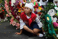 MEDELLIN, COL Aug 07 A girl rests among several flower arrangements in the parade Silleteros 59th in Medellin, Colombia, on August 7, 2016. (Photo by Fredy Builes / VIEWpress)