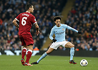 Liverpool's Dejan Lovren passes under pressure from Manchester City's Leroy Sane<br /> <br /> Photographer Rich Linley/CameraSport<br /> <br /> UEFA Champions League Quarter-Final Second Leg - Manchester City v Liverpool - Tuesday 10th April 2018 - The Etihad - Manchester<br />  <br /> World Copyright &copy; 2017 CameraSport. All rights reserved. 43 Linden Ave. Countesthorpe. Leicester. England. LE8 5PG - Tel: +44 (0) 116 277 4147 - admin@camerasport.com - www.camerasport.com