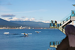 Float planes arriving and departing in Coal Harbor in downtown Vancouver, British Columbia, Canada