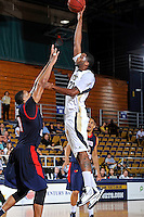 25 February 2012:  FIU center Brandon Moore (22) shoots over South Alabama center Augustine Rubit (21) in the second half as the FIU Golden Panthers defeated the University of South Alabama Jaguars, 81-74, at the U.S. Century Bank Arena in Miami, Florida.