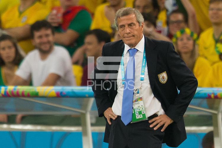 Uruguay manager Oscar Washington Tabarez looks dejected