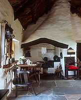 The cottage, both inside and out, has been handmade by Dorian Bowen, including the stick-backed chairs in the living room