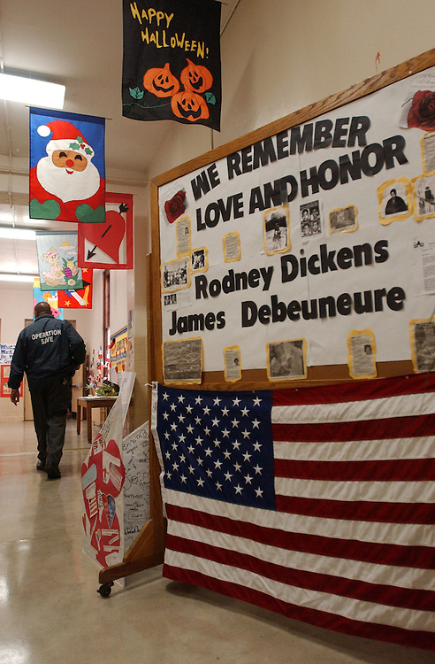 4hammer111401 -A sign in memory teacher James Debeuneure, and 6th grader Rodney Dickens who died in the crash at the Pentagon stands in a hall way at Ketchum Elementary.