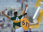 Mark McInerney of Clare in action against David Mangan of Kerry during their Munster Minor football final at Pairc Ui Chaoimh. Photograph by John Kelly.