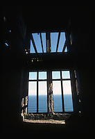 View of the South Pacific Ocean through the window of an abandoned home near Dunedin, New Zealand in 1995