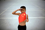 A Chinese Olympic team fan shows his support in Beijing, China on Monday, August 4, 2008. The city of Beijing is gearing up for the opening ceremonies of the Olympic Games.  Kevin German