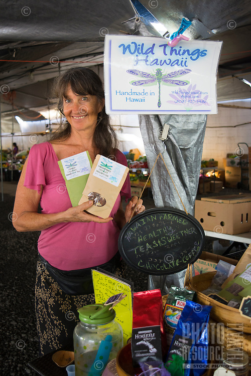 A local vendors holds Dragon Dust products at the Hilo Farmers Market, Big Island of Hawai'i.