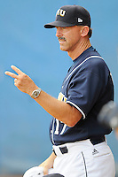 "24 February 2008: Florida International Baseball Head Coach Henry ""Turtle"" Thomas signals to his players during the Southern California 12-7 victory over FIU at University Park Stadium in Miami, Florida.  Stewart allowed only 2 hits and 2 runs in five innings."