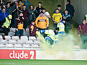 18/09/2010   Copyright  Pic : James Stewart.sct_jsp016_motherwell_v_aberdeen  .:: A STEWARD REMOVES A FLARE FROM THE MOTHERWELL SUPPORT ::.James Stewart Photography 19 Carronlea Drive, Falkirk. FK2 8DN      Vat Reg No. 607 6932 25.Telephone      : +44 (0)1324 570291 .Mobile              : +44 (0)7721 416997.E-mail  :  jim@jspa.co.uk.If you require further information then contact Jim Stewart on any of the numbers above.........