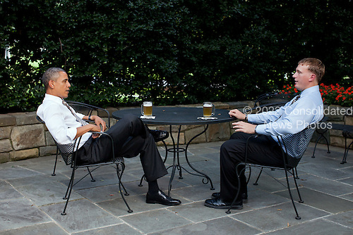 United States President Barack Obama enjoys a beer with Dakota Meyer on the patio outside of the Oval Office, Wednesday, September 14, 2011. The President will present Meyer with the Medal of Honor tomorrow during a ceremony at the White House. .Mandatory Credit: Pete Souza - White House via CNP