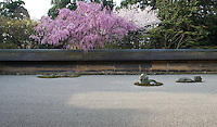 "The Ryoan-Ji garden was built in 1450 by Hosukawa Katsumoto in the ""dry landscape"" style and features sand, rocks and moss"