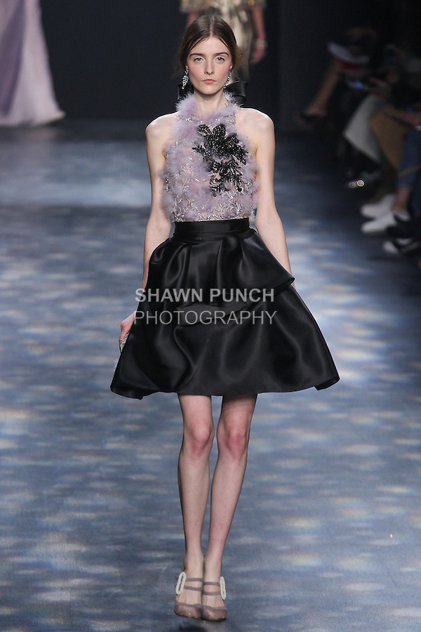 Model Morta walks runway in a halter neck cocktail with lilac feather embroidery and black beading with black satin-faced organza skirt, from the Marchesa Fall 2016 collection by Georgina Chapman and Keren Craig, presented at NYFW: The Shows Fall 2016, during New York Fashion Week Fall 2016.