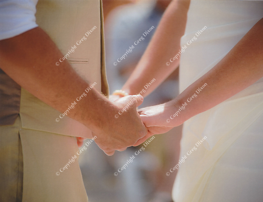 Jared takes Allison's hands during the exchange of vows