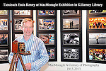 Taoiseach Enda Kenny pictured with a 100 years old Sanderson wooden camera at Killarney Library on Sunday when he visited a photographic exhibition celebrating 100 years of MacMonagle photography in Kerry.  The exhibition of over 100 photographs continues for the month of July.<br /> Photo: macMonagle<br /> <br /> REPRO FREE PHOTO