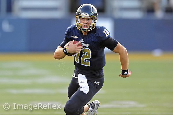 19 September 2015:  FIU quarterback Alex McGough (12) carries the ball for a 29-yard gain in the first quarter as the FIU Golden Panthers defeated the North Carolina Central University Eagles, 39-14, at FIU Stadium in Miami, Florida.