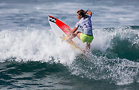 Huntington Beach, CA - Saturday August 4, 2018: Courtney Conlogue in action during a World Surf League (WSL) World Championship Tour (WCT) Round 3 heat at the 2018 Vans U.S. Open of Surfing on South side of the Huntington Beach pier.