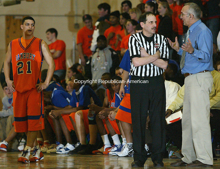 Danbury's coach Tom Pardalis questions a foul that an offical called Friday night at Wilby High School.  The Raiders defeated the Hatters 69 -63Michael Kabelka Republican / American.