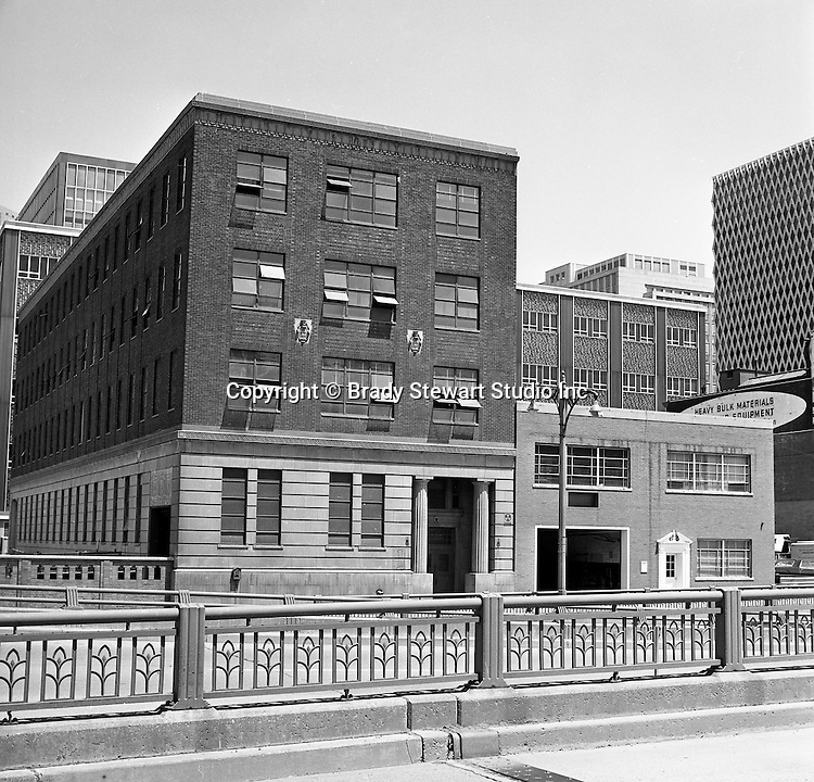 Pittsburgh PA:  View of businesses along Fort Pitt Boulevard.  Acme Janitor Service and Hyle and Patterson were two of the businesses on Fort Pitt Boulevard in 1966. This would be the future home of the Westinghouse Building which was completed in 1969.  United Steelworkers building in the background.